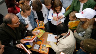 Photo of Более 500 человек одновременно читали книги в центре Киева
