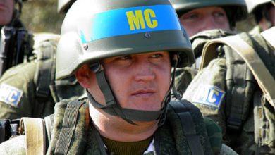 Photo of Российские военные с эмблемами миротворцев приближаются к границам Украины