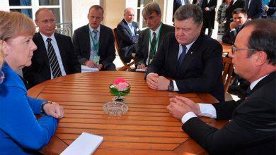 Photo of Переговоры в нормандском формате в Париже — мрачный Порошенко и улыбающийся Путин